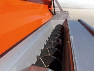Fully tapered trough eliminates all flat surfaces preventing material hang ups.
